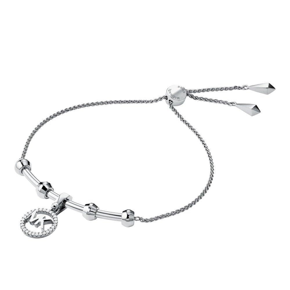 1c2bd7e928a79 Michael Kors Custom Silver & CZ Logo Charm Bracelet